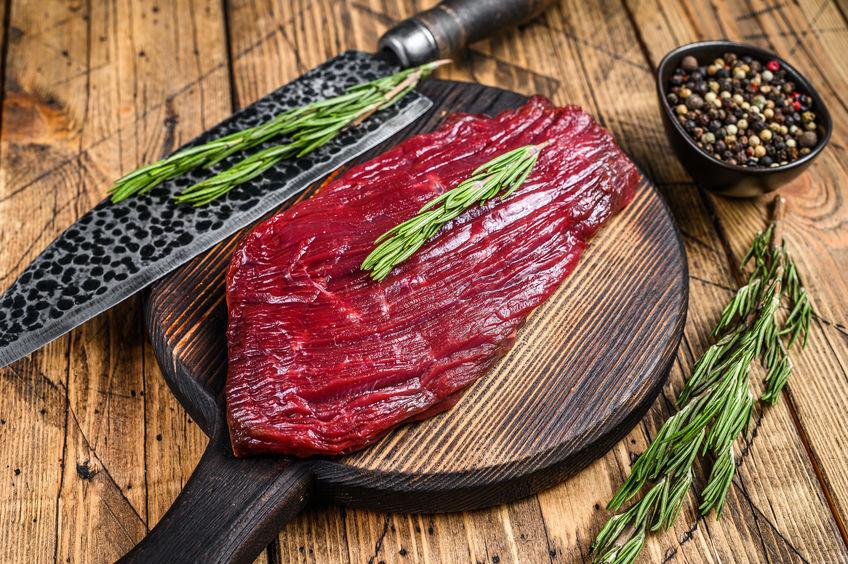 Elk raw steak from wild meat on a cutting board